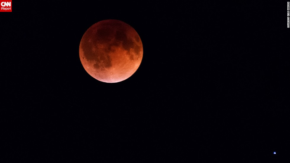 "<a href=""http://ireport.cnn.com/docs/DOC-1120730 "">Kyle Hansen</a> stood outside for an hour in 25-degree weather on April 15 to get this shot of the blood moon over Burnsville, Minnesota. He said it was ""very cool to see the shadow of the earth on the moon."""