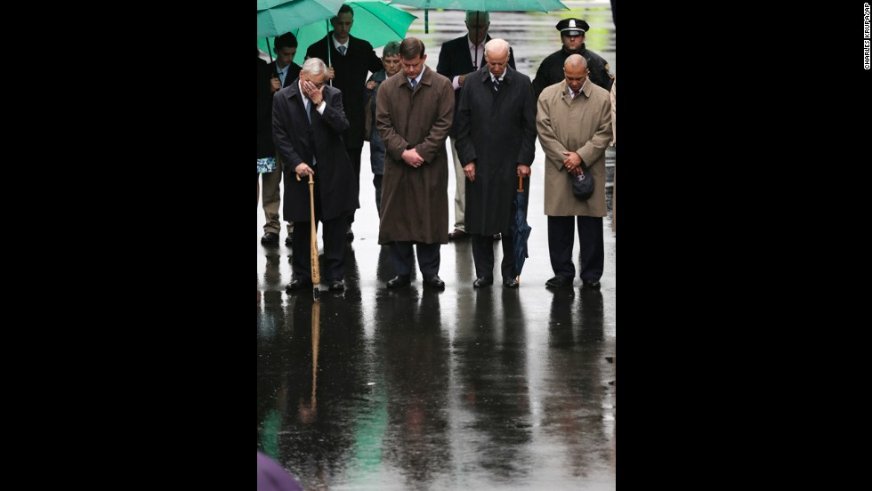 "From left, former Boston Mayor Tom Menino, Boston Mayor Martin Walsh, Vice President Joe Biden and Massachusetts Gov. Deval Patrick lower their heads for a moment of silence during the tribute. ""America will never, ever, ever stand down,"" Biden said during the ceremony. ""We are Boston. We are America. We respond, we endure, we overcome and we own the finish line."""