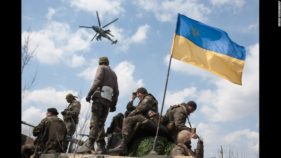 A Ukrainian helicopter flies over a column of Ukrainian Army combat vehicles on the way to Kramatorsk on April 16.
