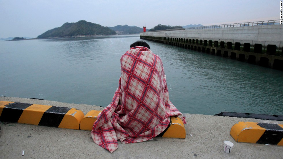 A relative waits for a missing loved one at the port in Jindo.