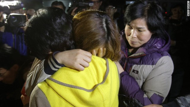 Families of missing ferry students wait