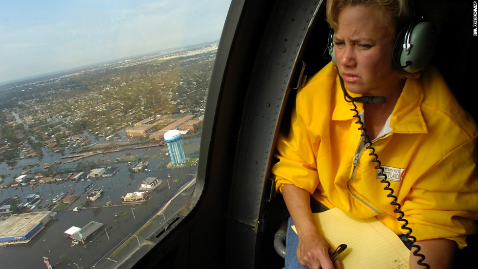 Landrieu looks over areas of New Orleans devastated by Hurricane Katrina during a helicopter tour with then-Gov. Kathleen Blanco on August 30, 2005. Landrieu would go on to staunchly criticize FEMA's handling of recovery efforts in the aftermath of the storm.