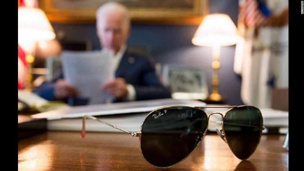 "U.S. Vice President Joe Biden has joined the popular photo-sharing website Instagram, and <a href=""http://instagram.com/p/m264zNlwTT/"" target=""_blank"">the first uploaded picture</a> shows Biden's aviator glasses with the vice president reading in the background. The caption with the photo said Biden will travel to Pennsylvania to tout a jobs plan with President Obama, and it promised more pictures of Biden's sunglasses to come. Click through the gallery to see more photos of Biden and what has become his signature eyewear."
