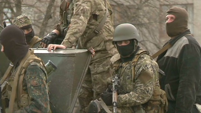 Ukrainian troops face militants in east