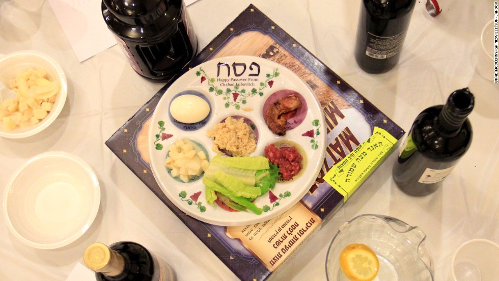 "A table setting for the Passover Seder at the Chabad House in Gainesville. The story of Exodus is told during the <a href=""http://religion.blogs.cnn.com/2011/04/18/let-my-people-go-understanding-the-passover-seder/"">traditional meal</a>."