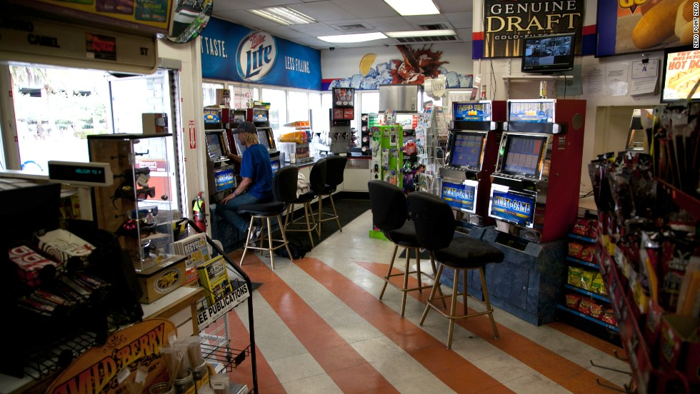 A man uses a Game King Multi-Game machine at a gas station in the desert outside Vegas.