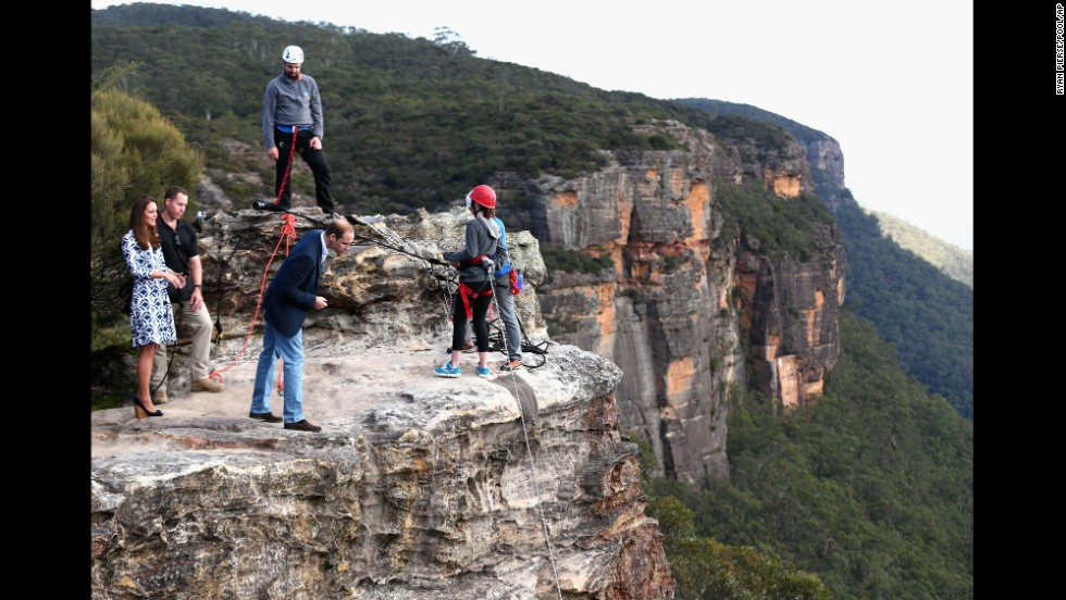 William peers over a cliff edge at Narrow Neck Lookout near Katoomba, Australia, as he and his wife observe team-building exercises by a youth group on April 17.