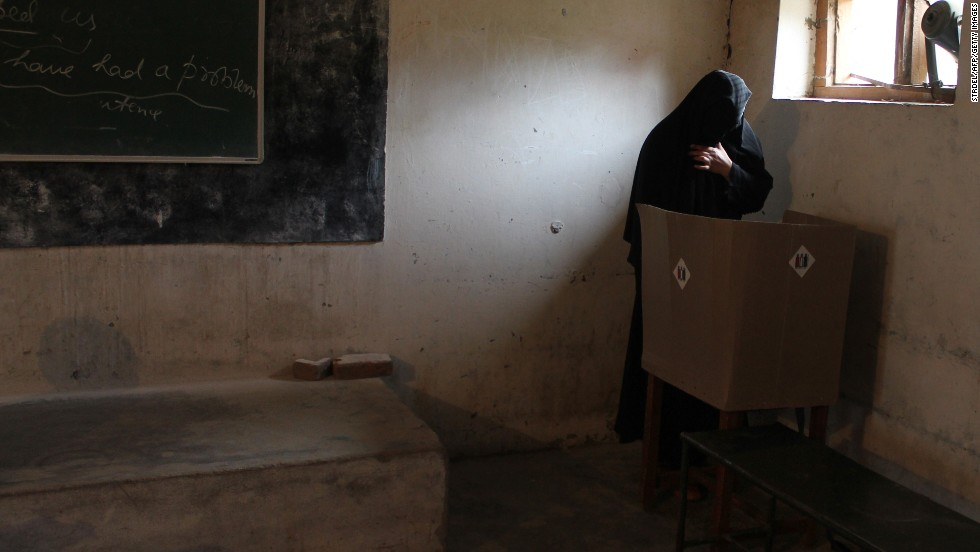 A voter casts her ballot at a polling booth in Doda, India, on April 17.
