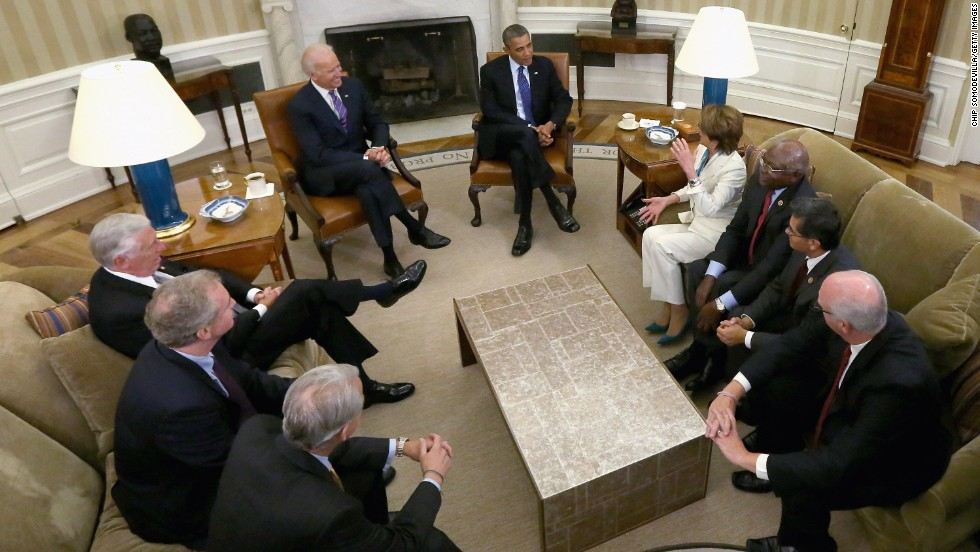 Obama and Biden meet with House Democratic leaders in the Oval Office of the White House in October 2013.