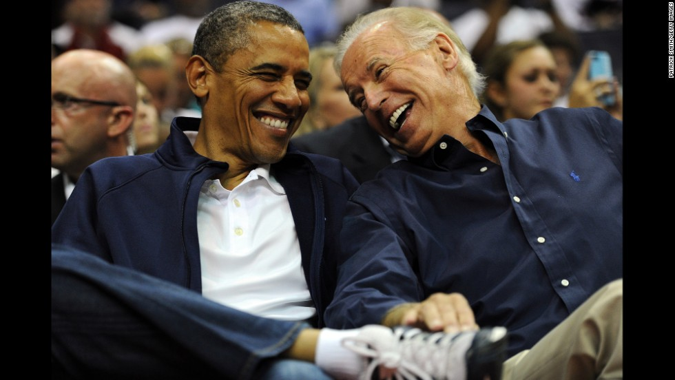 Obama and Biden share a laugh in July 2012 as the US men's basketball team played a exhibition game in Washington before the Olympics.