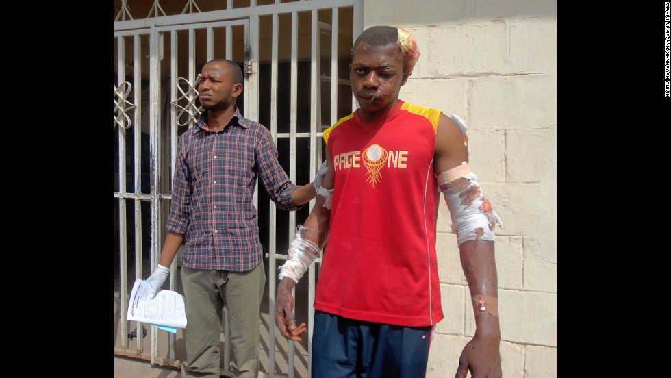 "A paramedic helps a young man as he leaves a hospital in the northern Nigerian city of Kano on January 21, 2012. A spate of bombings and shootings left more than 200 people dead in Nigeria's second-largest city. Three days later, a joint military task force in Nigeria <a href=""http://www.cnn.com/2012/01/24/world/africa/nigeria-attacks/"">arrested 158 suspected members</a> of Boko Haram."