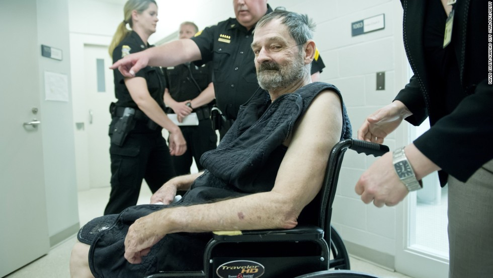 "Frazier Glenn Cross, a 73-year-old Missouri man with a long history of spouting anti-Semitic rhetoric, appears at his arraignment Tuesday, April 15, in New Century, Kansas. Cross has been charged with murder in the <a href=""http://www.cnn.com/2014/04/15/us/kansas-jewish-center-shooting/index.html"">shooting deaths</a> of three people: a boy and his grandfather outside a Jewish community center in Overland Park, Kansas, and a woman at a nearby assisted-living facility."