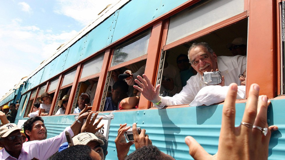 García Márquez waves out the window of a train in 2007 upon arriving in his hometown of Aracataca, Colombia.