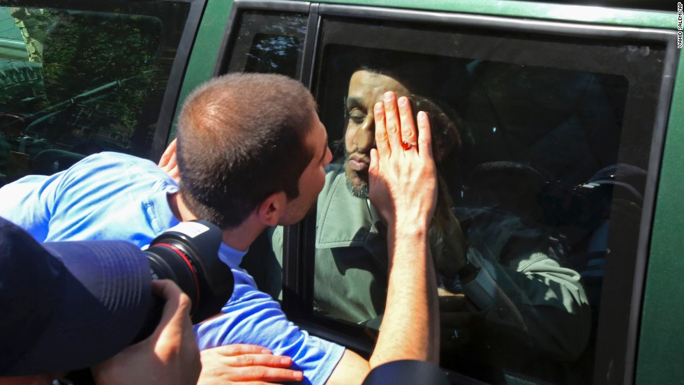 Former Iranian President Mahmoud Ahmadinejad kisses a well-wisher from behind the window of his car as he leaves Friday prayers in Tehran, Iran, on April 11.