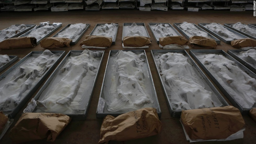 "Body remains, conserved with salt, are displayed at the Sejkovaca identification center near the Bosnian town of Sanski Most on Wednesday, April 16. The remains, <a href=""http://www.cnn.com/2013/11/01/world/europe/bosnia-mass-grave/index.html"">found in a mass grave last year</a>, are believed to be those of victims of Bosniak and Croat ethnicity who were killed in the summer of 1992, according to the Prosecutor's Office of Bosnia and Herzegovina. The mass grave, at Tomasica in Prijedor municipality, is one of the biggest found in Bosnia and Herzegovina since the breakup of the former Yugoslavia two decades ago."