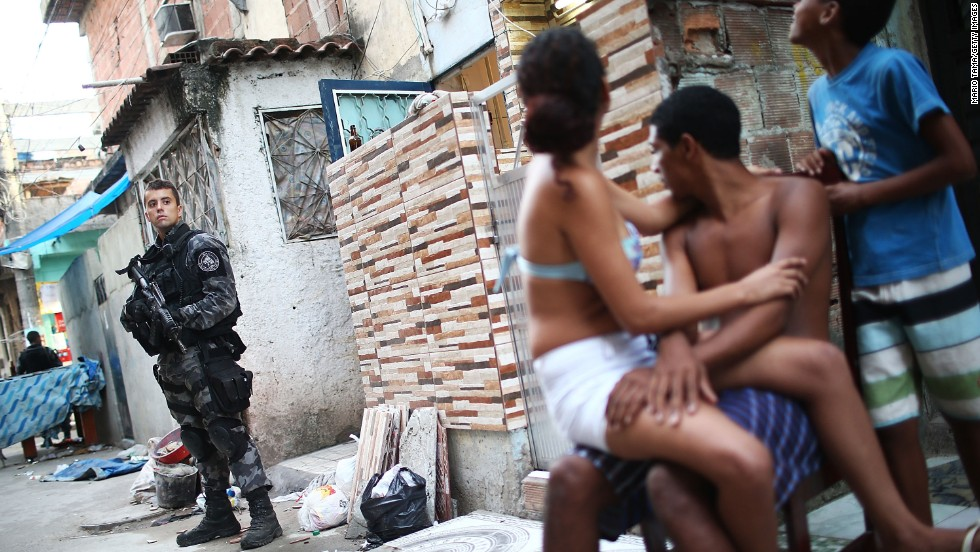 A Brazilian military police officer keeps watch after entering the Complexo da Mare, one of the largest slums, or favelas, in Rio de Janeiro, on March 30.