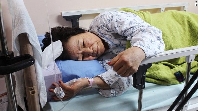 Shin Young Ja, 71, of Seoul was aboard the Sewol ferry when it capsized Wednesday. She is resting at a nearby hospital after breaking her back, and suffering glass injuries on her foot.