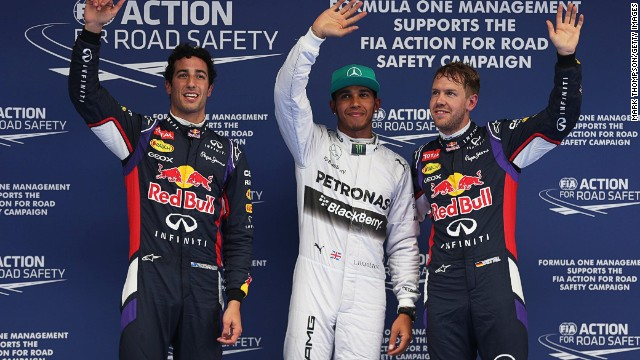 Lewis Hamilton (center) mastered the wet conditions best on Saturday and sits on pole for Sunday's Chinese Grand Prix.