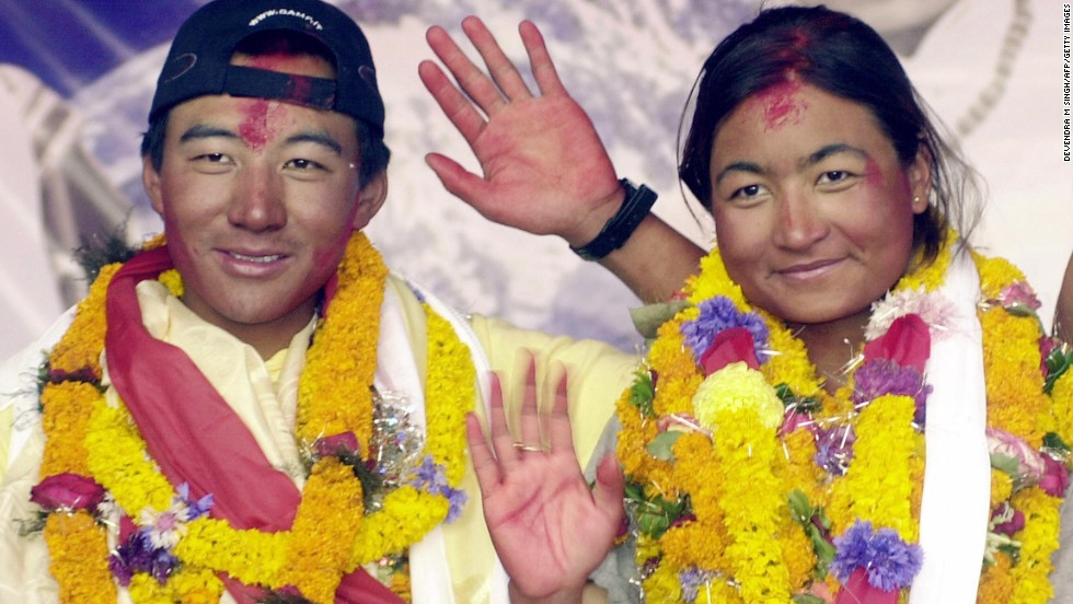 Pemba Dorje Sherpa and Moni Mulepati became the first people to get married on Everest's summit, on March 30, 2005. The couple are seen here waving from base camp on June 2, 2005.