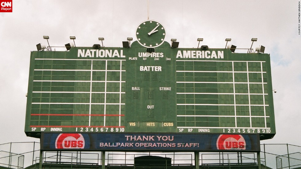 "Wrigley Field is one of the last parks to maintain a hand-turned scoreboard. No batted ball has ever hit the 1937 scoreboard, though pro-golfer Sam Snead <a href=""http://www.ballparks.com/baseball/national/wrigle.htm"" target=""_blank"">hit it with a golf ball</a> from home plate on Opening Day 1952. Briddick shot this photo while on a tour of the park."