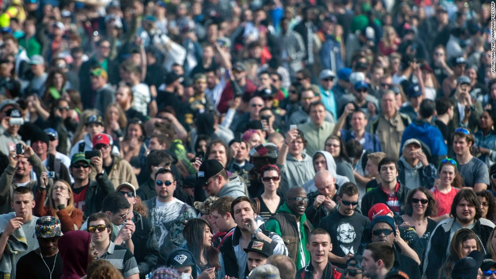 People gather on the lawns of Parliament Hill on April 20 during the Fill the Hill marijuana rally in Ottawa, Canada.