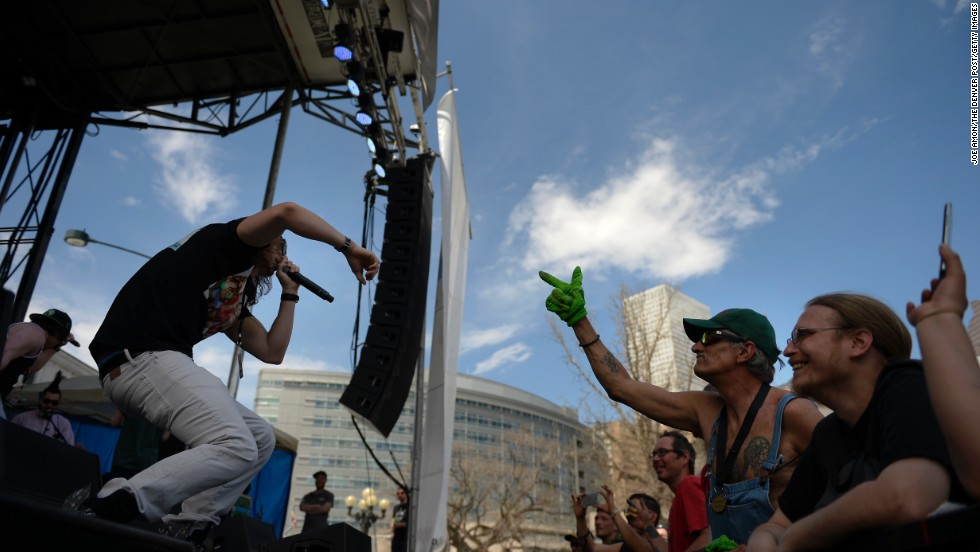 Fans react to the MTHDS as they preform during the 420 Rally in Denver's Civic Center Park on April 20.