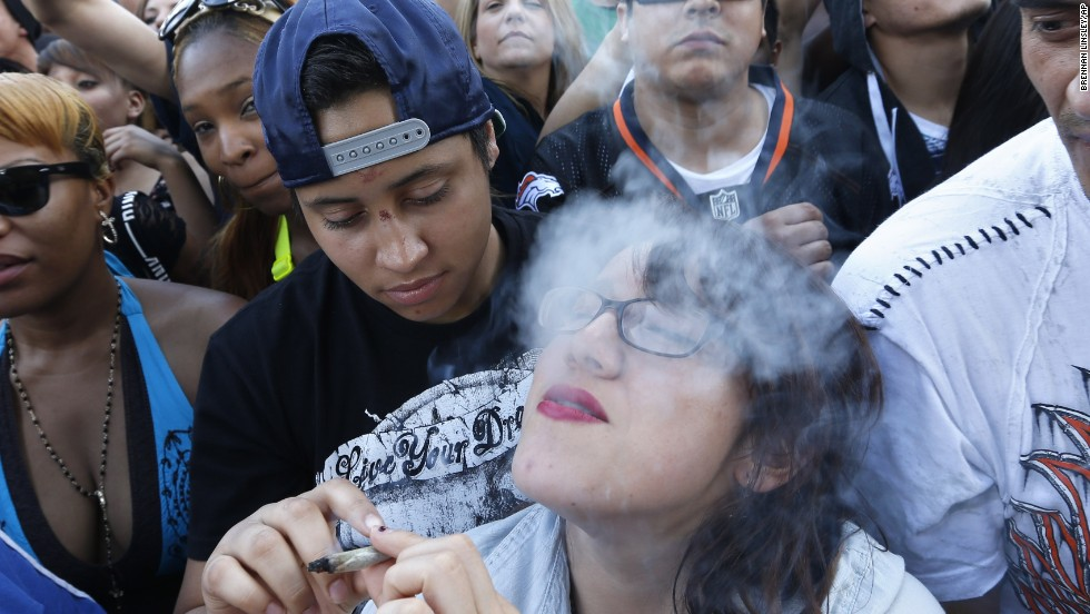 "Partygoers listen to live music and smoke pot on day two of the annual 420 Rally in Denver on Sunday, April 20, 2014. <a href=""http://www.cnn.com/2013/04/20/opinion/reiman-marijuana-day/"" target=""_blank"">420 is a once clandestine term used in pot culture to refer to marijuana. </a>"