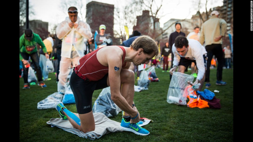 Runners prepare for the marathon on Boston Common on April 21.