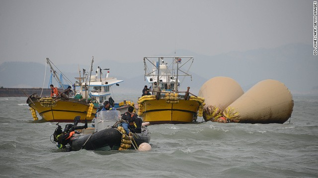 A diver enters the water at the site of the submerged 'Sewol' ferry off the coast of Jindo on April 21, 2014.