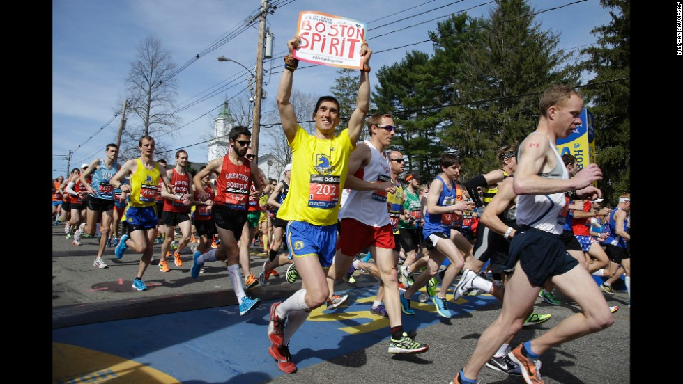 Runners in the first wave of 9,000 participants cross the starting line in Hopkinton, Massachusetts, on April 21.