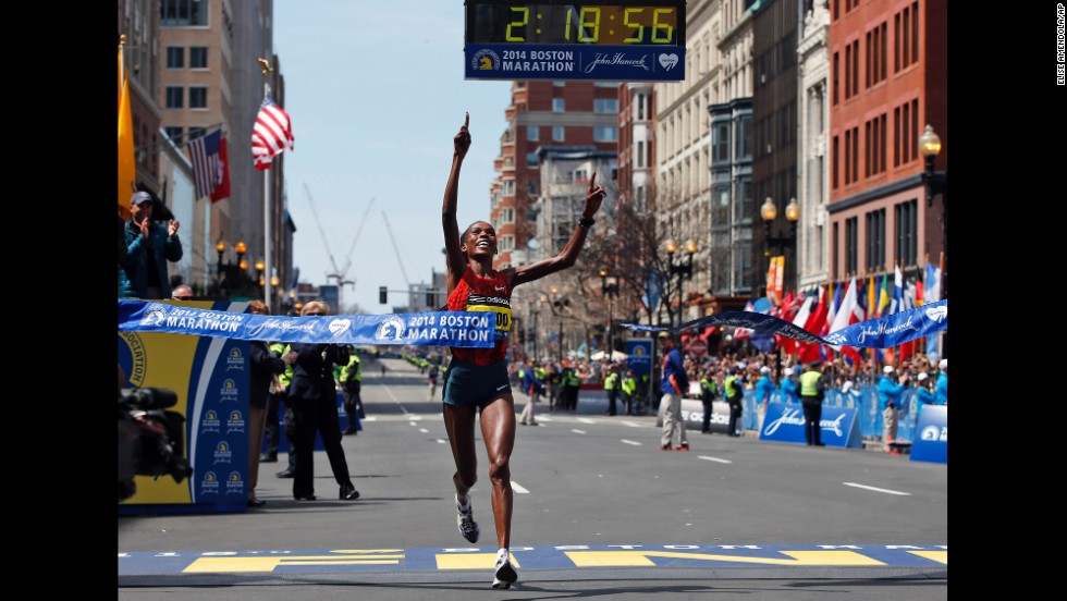 Rita Jeptoo of Kenya breaks the tape to win the women's division of the Boston Marathon.