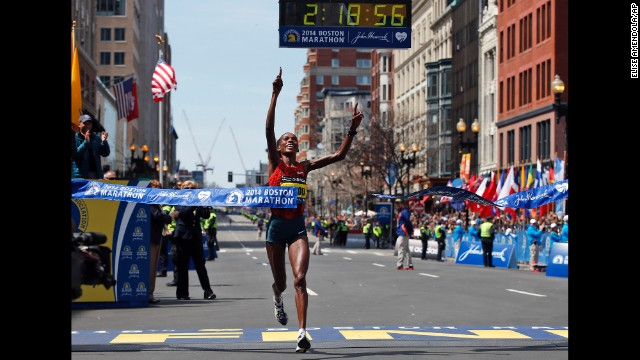 Rita Jeptoo of Kenya breaks the tape to win the women's division of the Boston Marathon in downtown Boston on Monday, April 21.