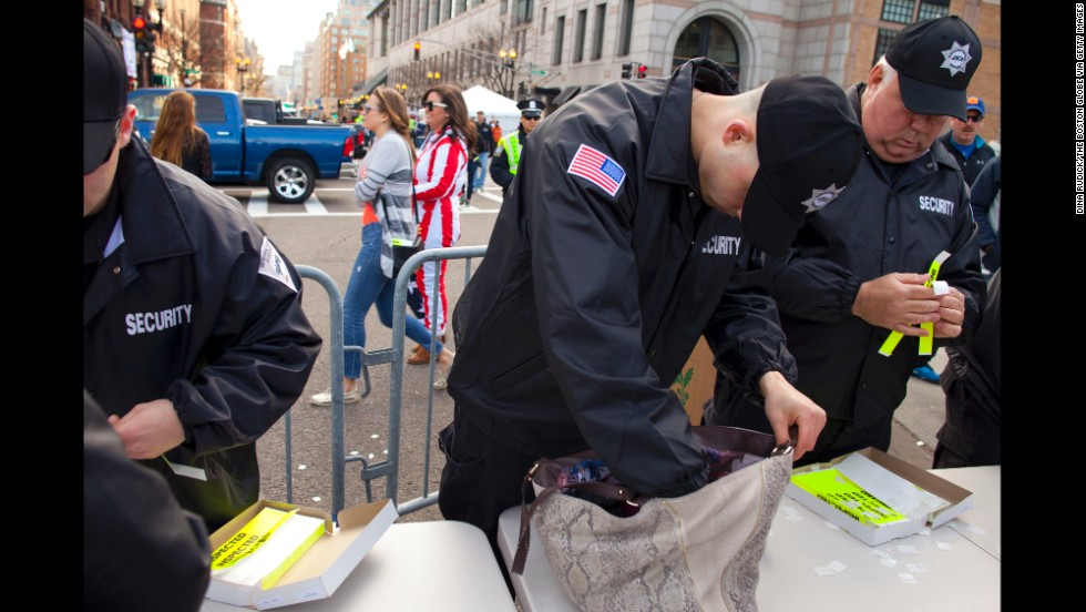 Security officers check bags near the finish line on Boylston Street on April 21.