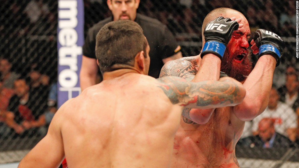 Fabricio Werdum, left, punches Travis Browne in their heavyweight bout during the FOX UFC event on April 19 in Orlando.