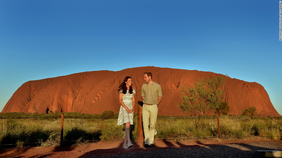 The royal couple pose in front of Ayers Rock in Australia on Tuesday, April 22.