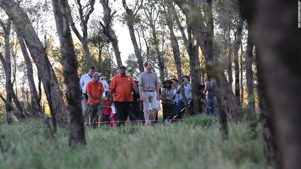 Prince William is guided along the Kuniya walk at Uluru, Australia, with a group on April 22.