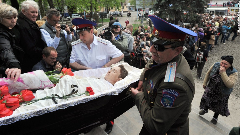 Cossacks carry a coffin into a church in Slovyansk on Tuesday, April 22, during a funeral for men killed in a gunfight at a checkpoint two days before.