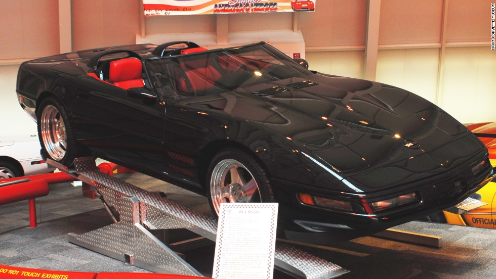 "This 1993 ZR-1 Spyder, on loan from General Motors, was built with""unique hood and front quarter panel vents"" to help cool the engine. The car's windshield and side glass were designed to sit lower than other Corvettes to give it an even sleeker profile. Although the museum lists this modified car's year as 1993, mechanically, the Spyder is a stock 1990,<a href=""http://corvettemuseum.blogspot.com/2014/04/zr-1-spyder-recovered-from-sinkhole.html"" target=""_blank""> according to the museum</a>."