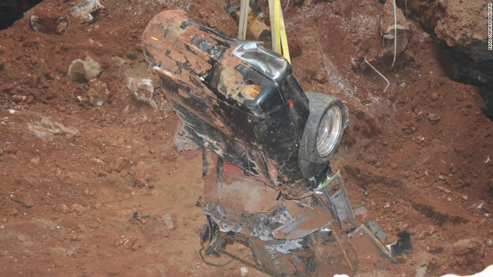 "As a crane pulled the Spyder from underground, museum officials said it became apparent it was among the worst damaged. A large boulder was found lodged in the Spyder's cabin, according to the museum website. At the time of the sinkhole collapse, the car was on display with its hood open. The fall snapped the hood off, <a href=""http://corvettemuseum.blogspot.com/2014/04/zr-1-spyder-recovered-from-sinkhole.html"" target=""_blank"">the website said</a>."