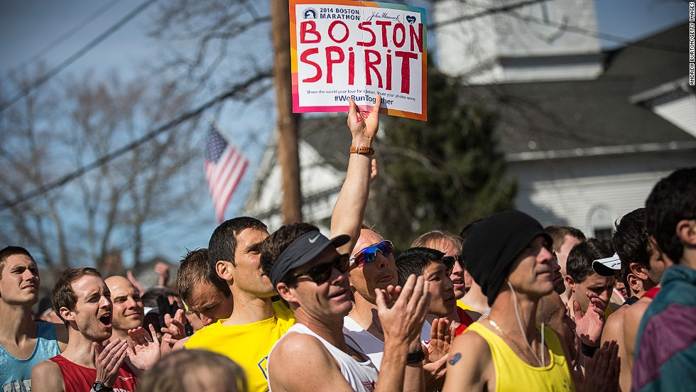 "APRIL 22 - HOPKINGTON, MASSACHUSETTS: Runners wait for the starting pistol at the beginning of the 118th <a href=""http://www.cnn.com/2014/04/21/us/boston-marathon/"">Boston Marathon</a> on April 21. Security at the 2014 race was increased a year after two bombs were detonated close to the finish line, killing three people and injuring more than 260 others."
