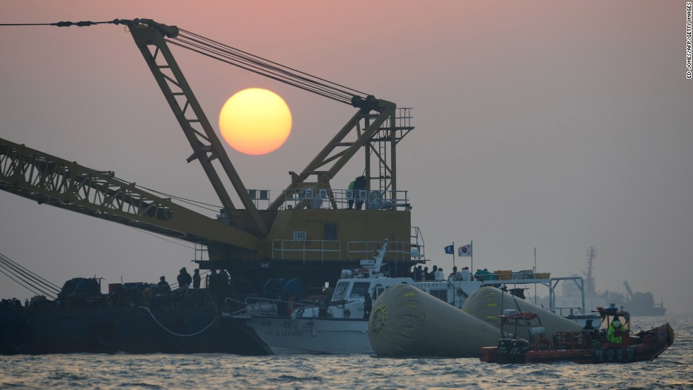 The sun sets over the site of the sunken ferry on April 22.