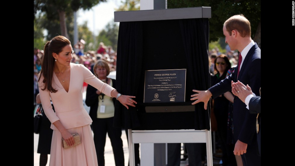 Prince William and his wife unveil a plaque naming a plaza after their son, Prince George, outside the Playford Civic Centre in Adelaide on April 23.