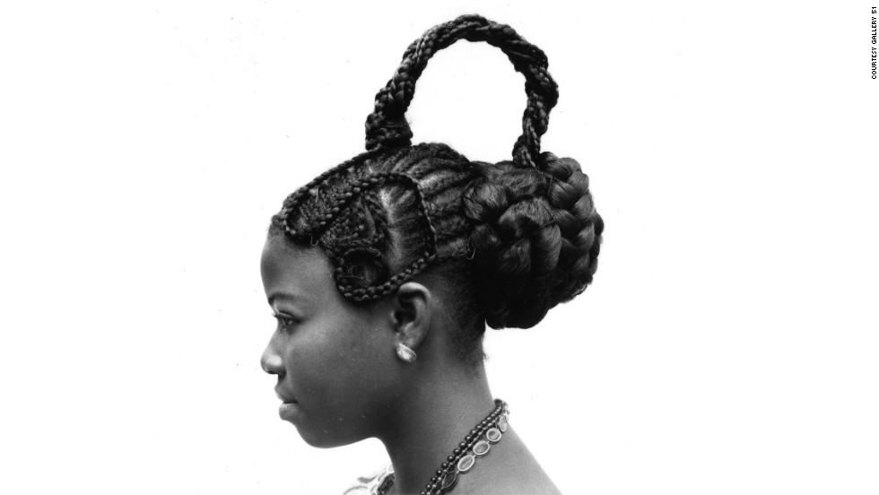 Abebe, 1975. These images of Nigerian hairstyles were taken by world-renowned photographer J. D. 'Okhai Ojeikere. He travelled the streets of 1960s Lagos with his Brownie D camera, capturing the intricately designed hairstyles of his fellow country people.