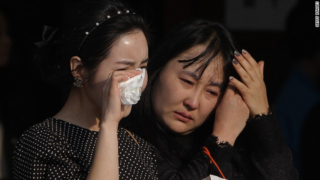 Families grieve as ferry death toll rises