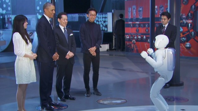 Obama plays soccer with a robot