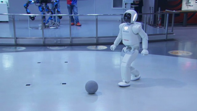 Obama kicks soccer ball with robot