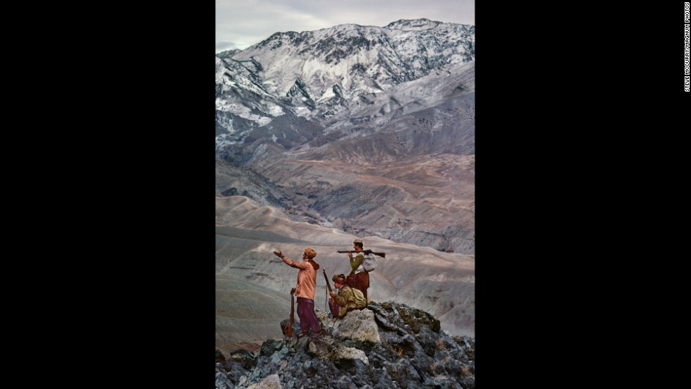 Mujahedeen stand atop a mountain in the Hindu Kush, 1984.