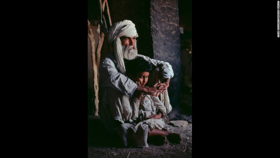 A father and son in Helmand province, 1980.