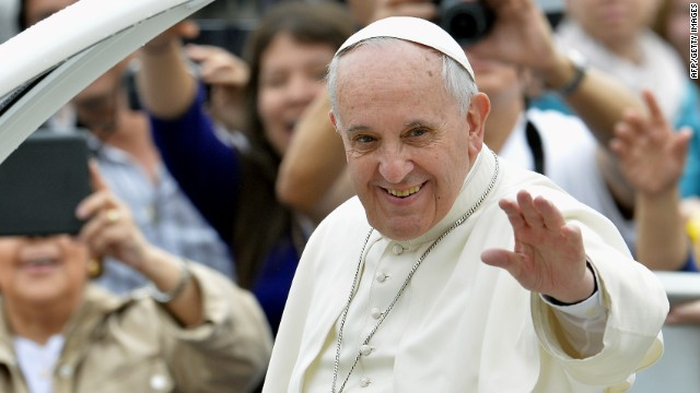 Pope Francis waves to pilgrims upon his arrival in St Peter's square at the Vatican, on April 23, 2014.