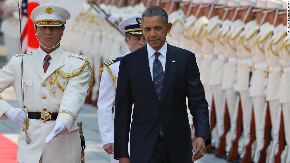 Obama reviews an honor guard during a welcoming ceremony at the Imperial Palace in Tokyo on April 24.